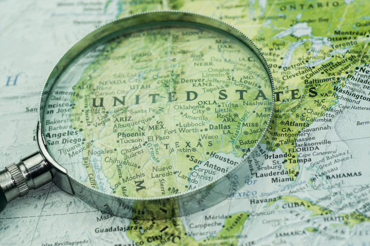 A magnifier glass over USA map